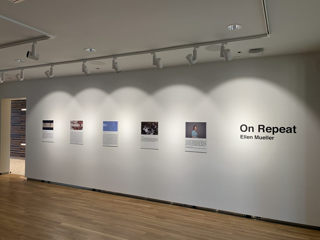 """On Repeat"" exhibition on wall"