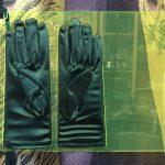 Green gloves in neon plastic holder