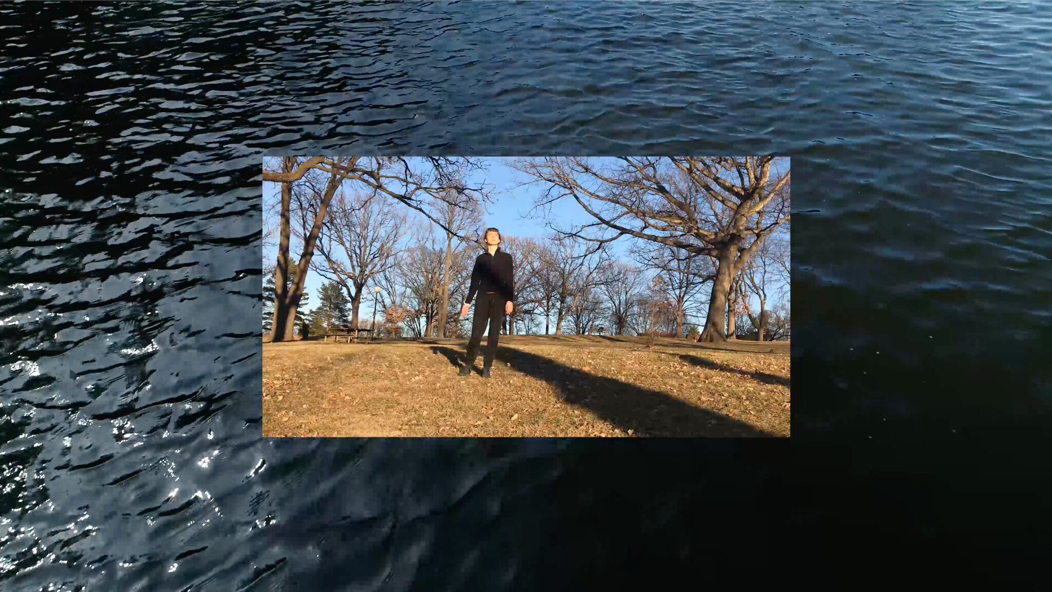 person leaning standing in nature with water behind