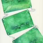 watercolor of a credit card that says 'adornment'